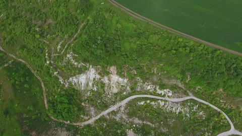 Aerial view of the quarry. Sand hills of abandoned quarry. Green nature. Summer Footage