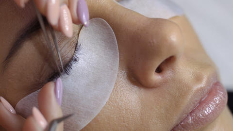 Eyelash extension in beauty salon Footage