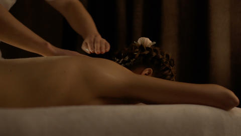 Young woman relaxing during massage in spa center Footage