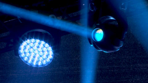 Professional lighting equipment on stage during a performance of popular rock Live Action