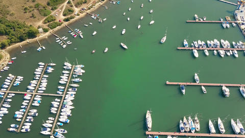 Anchored boats, motorboats and sailboats at the Adriatic sea marina piers Footage