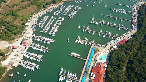 Multiple parked boats, motorboats and sailboats at marina piers Footage