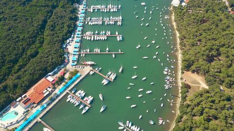 Boats, motorboats and sailboats at marina piers in Pula Croatia Footage