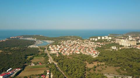 Marina piers and the Adriatic sea coast and houses in Pula Croatia Footage