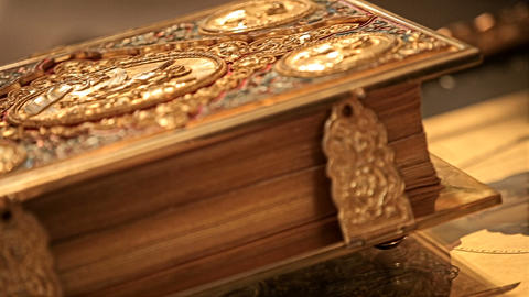 Expensive inlaid church book lies on the table Footage