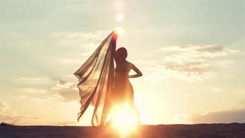 Silhouette of Dancing Woman at Sunset Footage