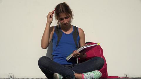 C0189 thinking female teenage student having an idea Live Action
