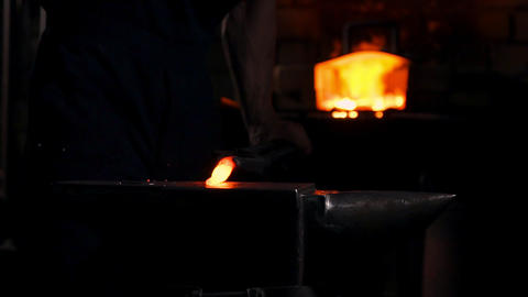 Get out of the furnace hot metal to make a sword war. Master of ancient art Footage