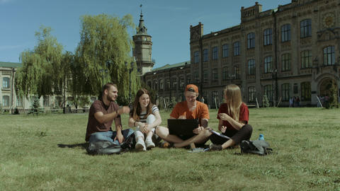 Excited students checking approved exam on laptop Footage
