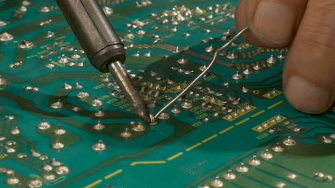 Soldering with tin on the electronic board Footage