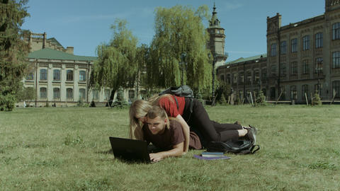 College students enjoying leisure on campus lawn Footage