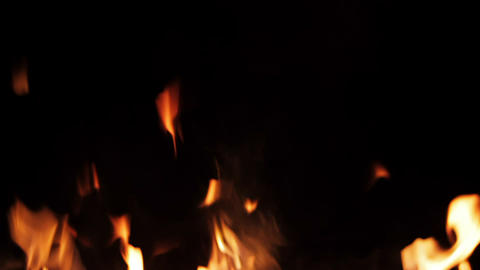 Real fire isolated on black background, loop video Footage
