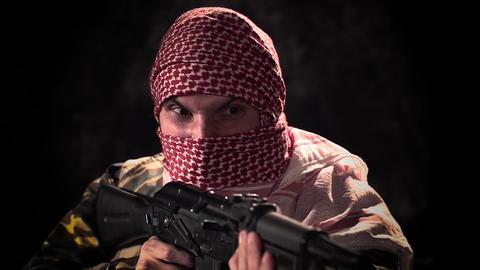 Balaclava angry terrorist with machine gun threat Stock Video Footage