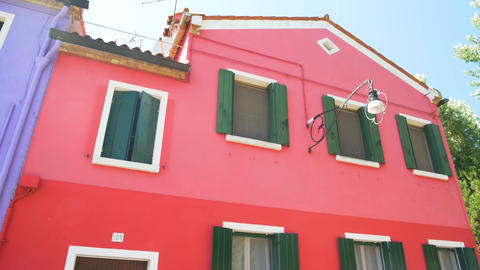 Panorama of wonderful red and purple doll-like houses in Burano, Venice Footage