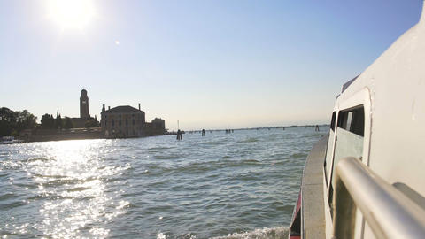 Water transport in Venice, view from the boat on Grand Canal, sun reflections Footage