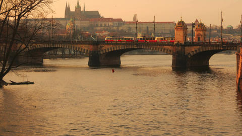 Two Trams Crossing the Legion Bridge in Prague During Sunset Footage
