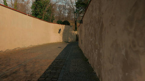 Intimate POV Walking Shot in an Old Prague Alleyway Footage