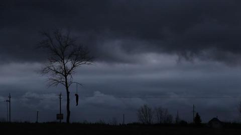 Hanged man on dark gloomy background Footage