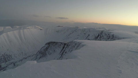 Aerial shot of snowy mountains in the north Footage