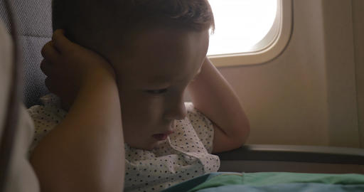 Kid shutting ears at the airplane Live Action