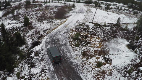 Car driving in northern town, aerial view Footage