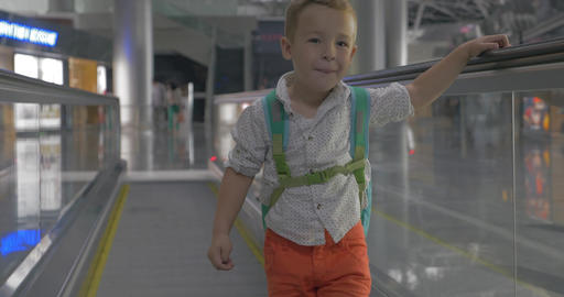 Cute little boy on travelator in airport Live Action