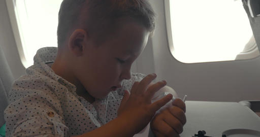 Child using smart watch during air travel Footage