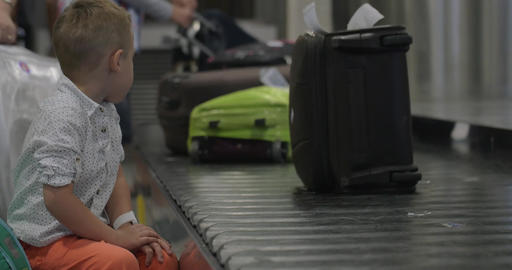 Little child at baggage claim area Footage