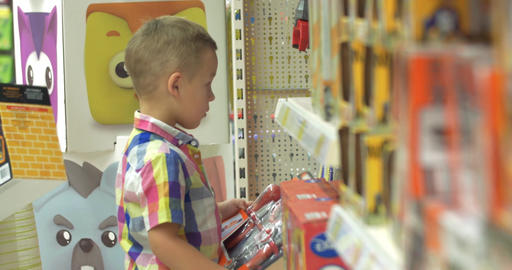 Boy Choosing Toys in the Shop Footage