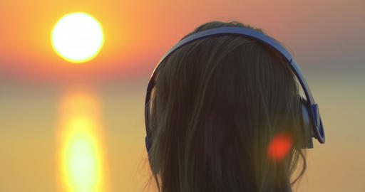 Woman enjoying music and sunset Footage