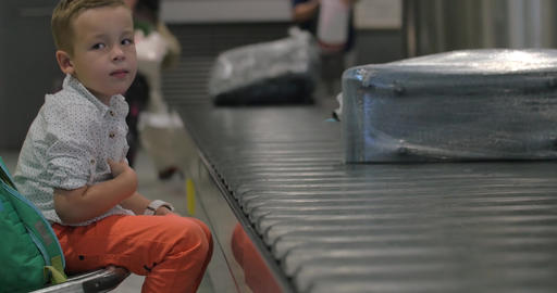 Child waiting at the baggage claim area Footage