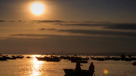 Fishing Boat Silhouette Rows in Sea Bay at Sunset in Vietnam Footage