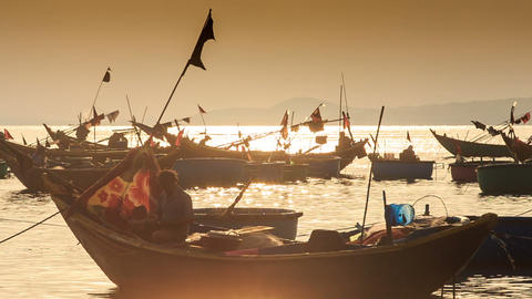 Closeup Fishing Boat Silhouettes in Sea Bay at Sunset in Vietnam Footage