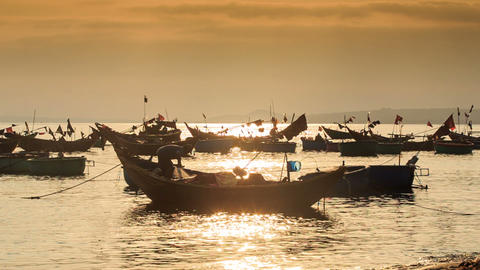 Fishing Boat Silhouettes in Sea Bay by Beach at Sunset Footage