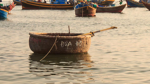 Empty Round Vietnamese Fishing Boat Floats on Sea Footage