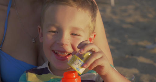 Little happy child blowing bubbles outdoor Footage