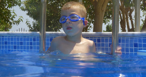 Smiling Boy in Goggles in Swimming Pool Footage