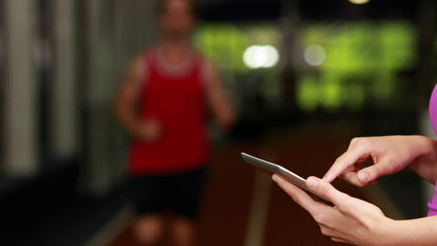 Female trainer checking results on tablet Footage