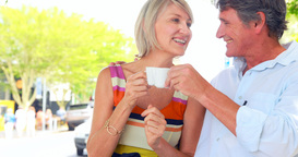 Smiling couple drinking coffee Footage