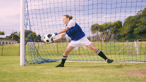 Goalkeeper in blue making a save Footage