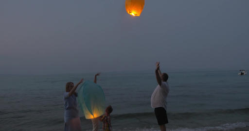 Happy Family Releasing Sky Lantern 影片素材