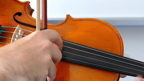 man playing violin over dark background. 4K, UHD Violinist playing the violin at Live Action