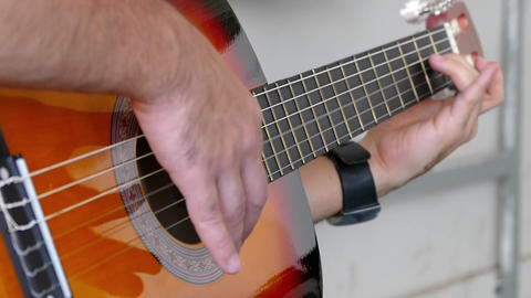 a musician plays a solo guitar, Man playing guitar Video guitar playing close Live Action