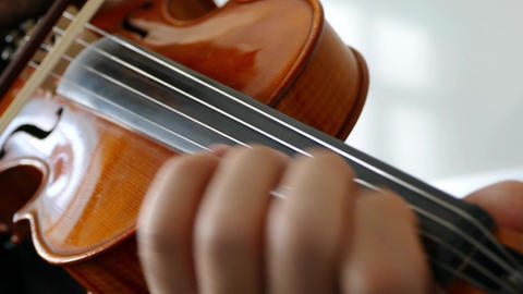 a musician plays a violin, classic turkish music Close-up of musician playing Footage