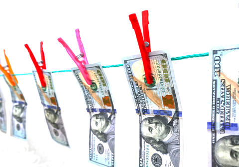 100 USA dollars hanging on the laundry rope 100 usa dollars are hanging with Photo