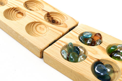 wooden mancala and stones, playing intelligence and mancala フォト