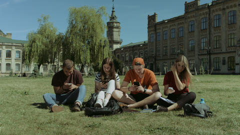 Students with cellphones ignoring each other Footage