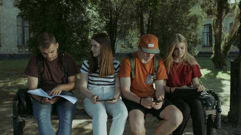College students studying togehter on the bench GIF
