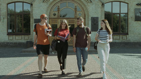Students walking and communicating in campus Footage