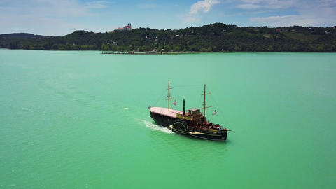 4K Drone flying above nostalgia boat on Lake Balaton towards Tihany Abbey Live Action